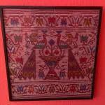 Item 39. Peruvian woven framed textile art panel, two peacocks on fountain.