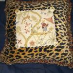 Textured cheetah print throw pillow