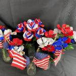 Red, White, and Blue Flowers in Milk Jug Bottle Vases