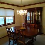 Wood Dining Room table with 6 chairs and an extra leaf.