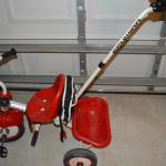 Kids tricycle with push handle