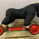 Old riding toy horse on wheels