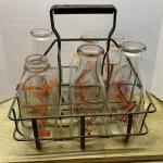 Antique milk bottles & carrier