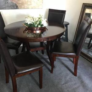 Photo of Beautiful dark Table and Chairs