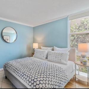 Photo of Modern platform queen bed in beige fabric