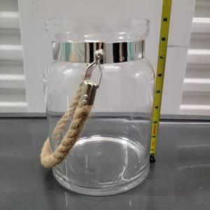 Photo of Glass lantern with rope handle