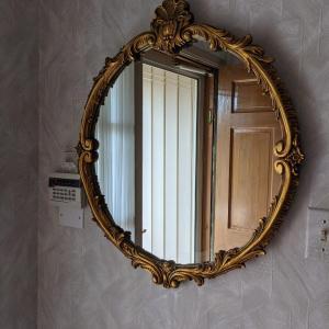Photo of Vintage Bronze round mirror