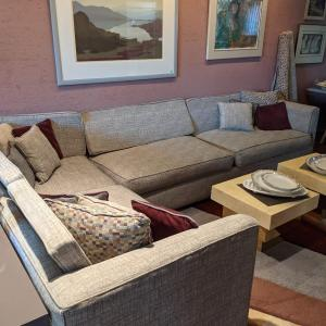 Photo of Grey custom upholstered L-shaped sectional sofa.