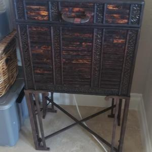 Photo of Brown Storage Box on Metal Stand