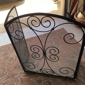Photo of Solid substantial fireplace screen with charming decor.