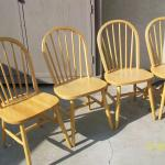 Four blond wood chairs