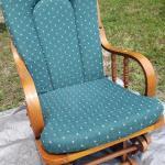Wood Rocker green cushions.