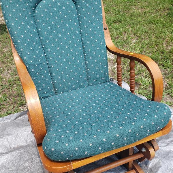 Photo of Wood Rocker green cushions.