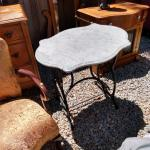Antique Singer sewing machine stand with a marble top