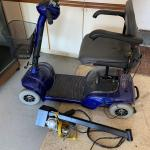 Scooter with lift for automobile