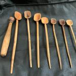 Primitive set of hand carved spoons and pestle