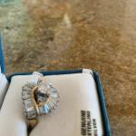 Brand new genuine silver- gold ring. Never used. With  Sapphire.