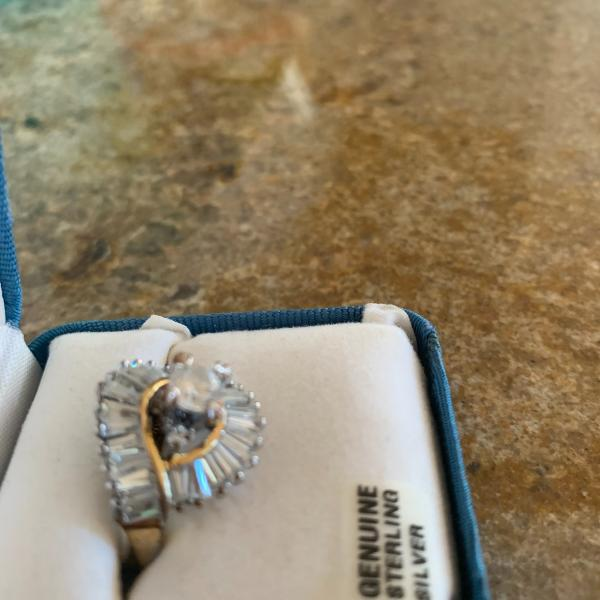 Photo of Brand new genuine silver- gold ring. Never used. With  Sapphire.