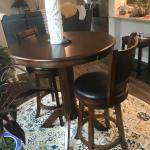 Pub table and two high back swivel barstools