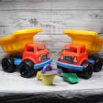 Pair of Plastic Beach Dump Truck Toys