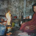 PHOTGRAPH OF A YOUNG TIBETAN BOY  BY CAMPING FIRE