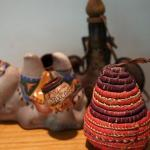 CERAMIC CAMEL/WOVEN COLORFUL BASKET  AND A LEATHER TOOLED BOTTLE EGYPT