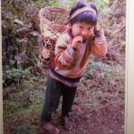PHOTOGRAPH OF YOUNG ASIAN CHILD CARRYING BASKET