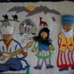 INUIT FABRIC ART OF THREE FIGURES OF RELIEF FELTS AND COTTON FABRICS.