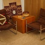 PAIR OF CHROME FRAME CHAIRS WITH LEATHER SLING STYLE ARMS AND FABRIC SUPPORT