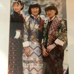 PHOTOGRAPH OF THREE ASIAN WOMEN IN ETHNIC CLOTHING