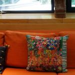 GROUPING OF FOUR FABRIC SOUTH AMERICAN NEEDLEWORK PILLOW.