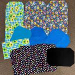 Homemade cloth placemats, three sets, balloons and flowers
