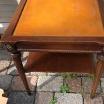 Antique side tables with leather tops