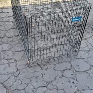Photo of Large dog cauge.