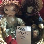 2 dolls in a basket