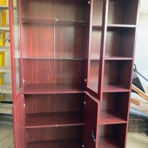 Photo of Glass door bookcase shelving unit