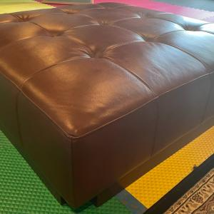 Photo of Brown Leather Ottoman