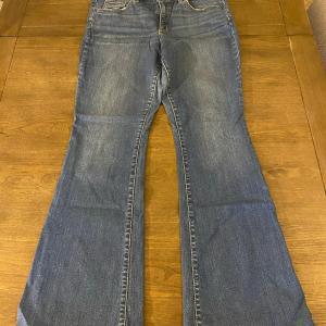 Photo of Universal Thread Medium Wash Blue Denim High Rise Flare Jeans Size 14